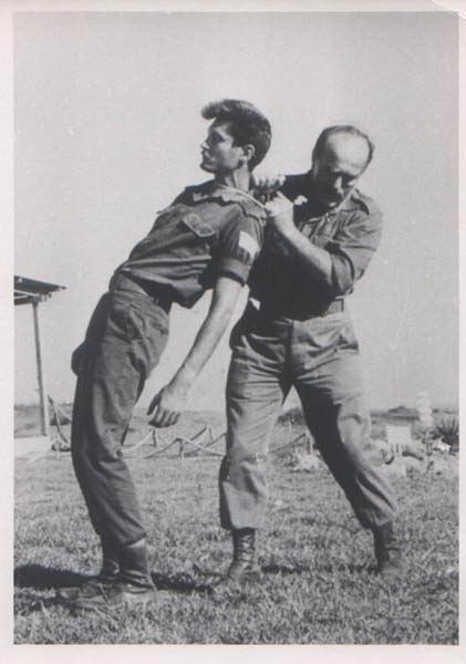 Old black and white photo with two men fighting