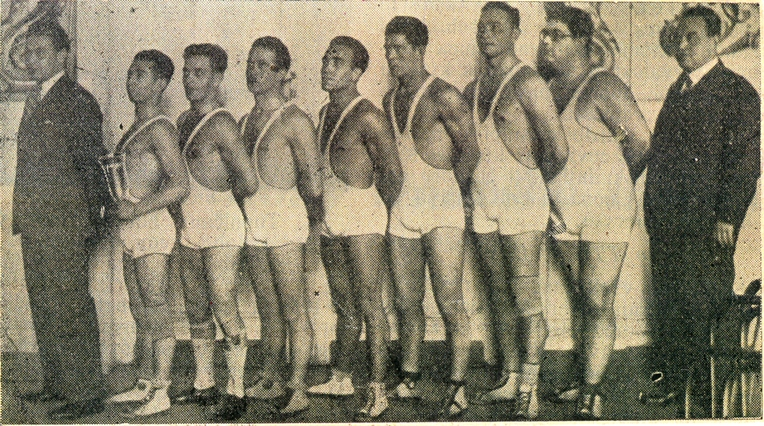 Old photo with nine men in sportsuits